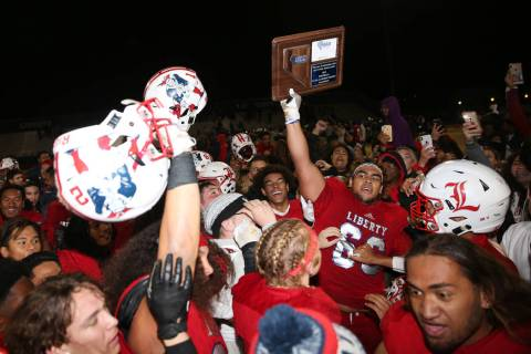 Liberty celebrates their 30-24 overtime win against Bishop Gorman in the football playoff game ...