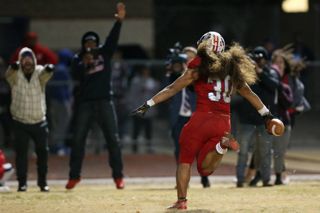 Liberty's Zyrus Fiaseu (30) scores a rushing touchdown to win in overtime against Bishop Gorman ...