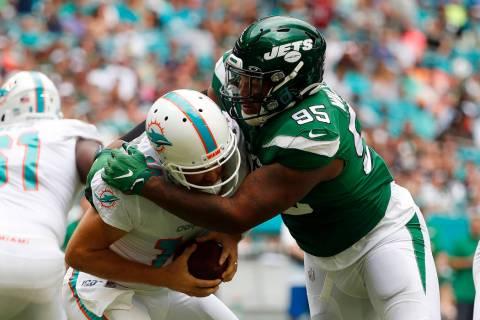 New York Jets defensive tackle Quinnen Williams (95) sacks Miami Dolphins quarterback Ryan Fitz ...