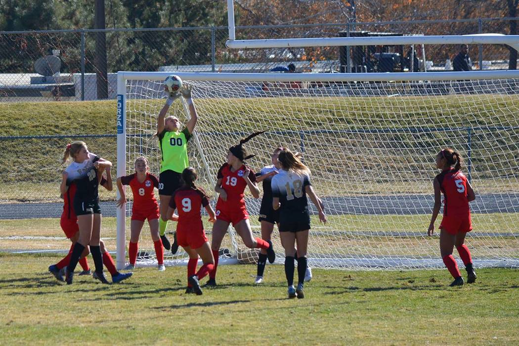 Courtesy photo The Faith Lutheran girls soccer team attacks the Coronado goal during a 1-0 win ...