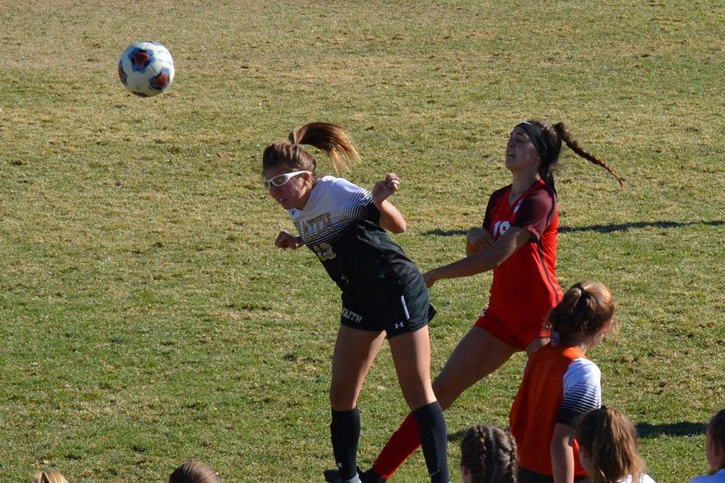 Courtesy photo The Faith Lutheran girls soccer team gains possession during a 1-0 win over Cor ...