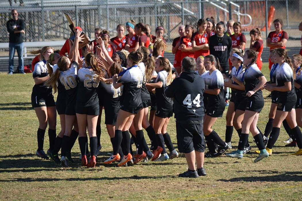 Courtesy photo The Faith Lutheran girls soccer team celebrates the school's first-ever Class 4 ...