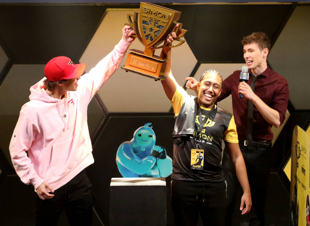 Daryl John, known online as Bugzvii, celebrates after winning the Simon Cup at the HyperX Espor ...