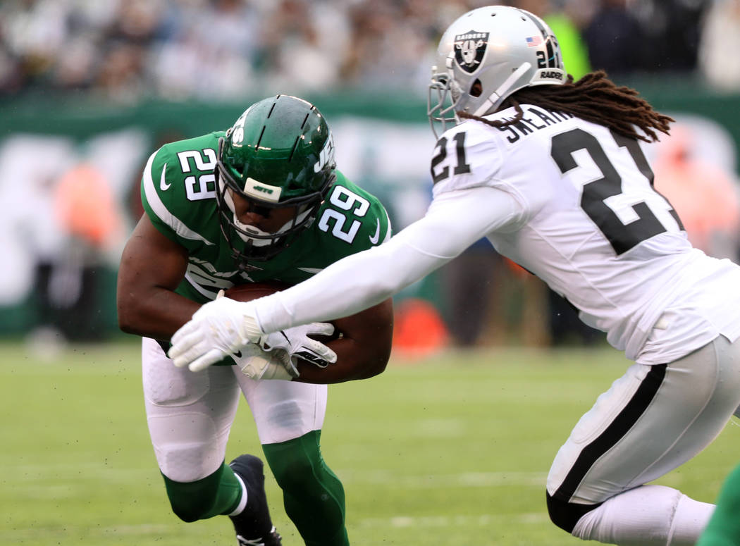 New York Jets running back Bilal Powell (29) runs with the football as Oakland Raiders free saf ...