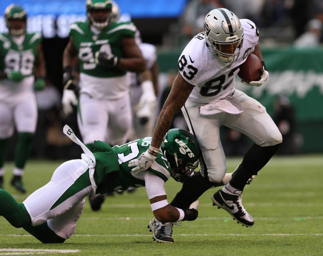 Oakland Raiders tight end Darren Waller (83) tries to break a tackle by New York Jets strong sa ...