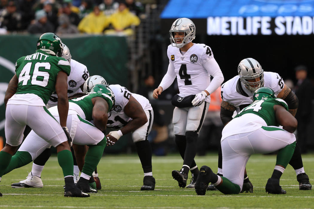 Oakland Raiders quarterback Derek Carr (4) calls a play at the line of scrimmage during the fir ...