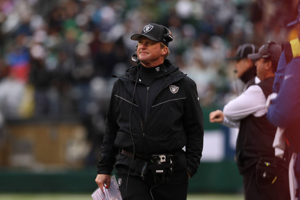 Oakland Raiders head coach Jon Gruden looks to the scoreboard during the first half of an NFL g ...