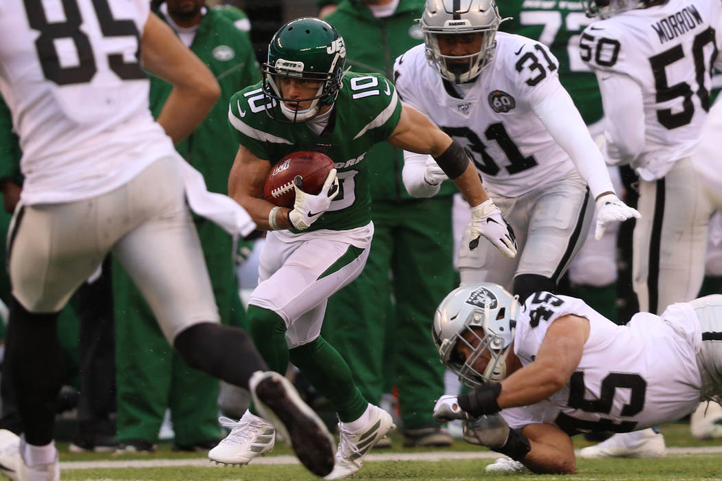 New York Jets wide receiver Braxton Berrios (10) breaks a tackle from Oakland Raiders running b ...