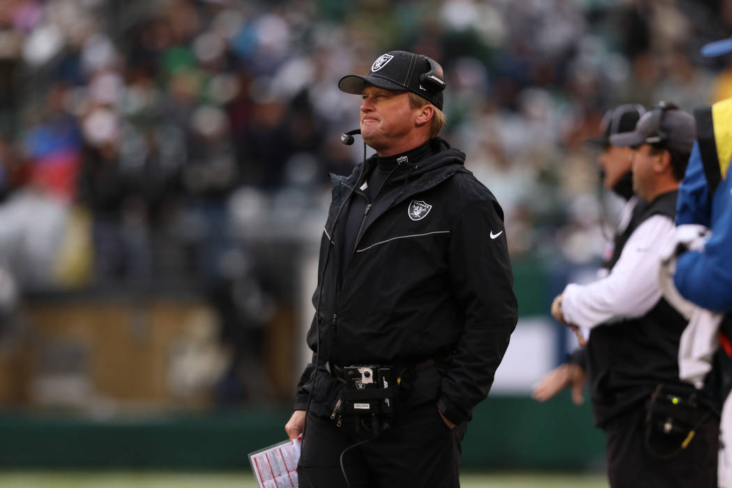 Oakland Raiders head coach Jon Gruden looks on from the sideline during the first half of an NF ...