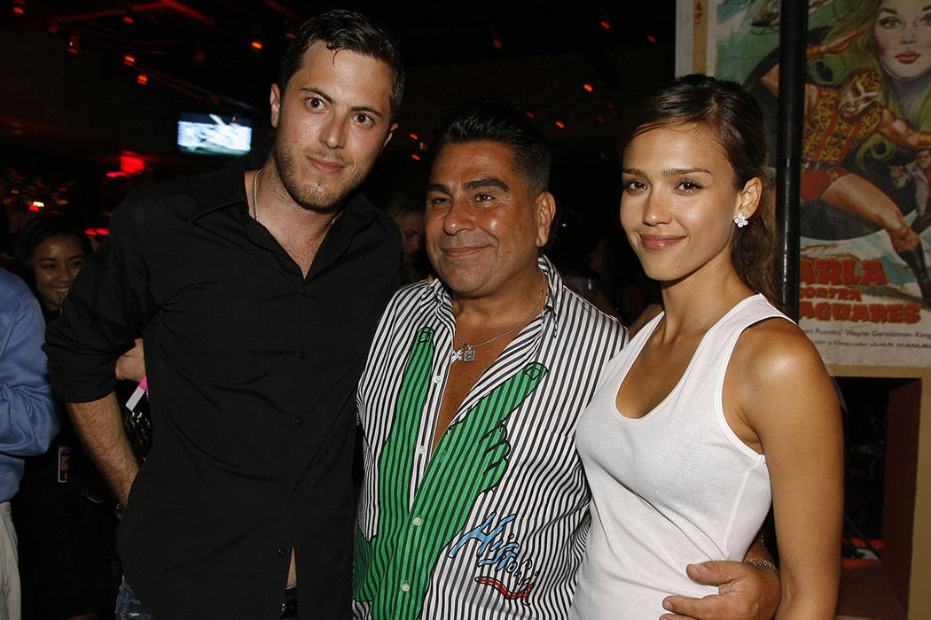 Harry Morton, left, Luis Barajas, center, founder of Flaunt magazine, and Jessica Alba are seen ...