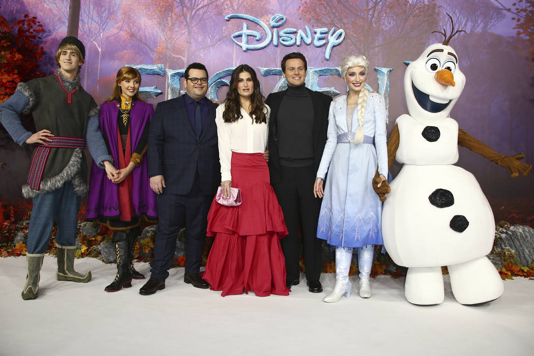 Character actors Voice actors from left to right, Kristoff, Anna, Elsa (2nd from right) and Ola ...