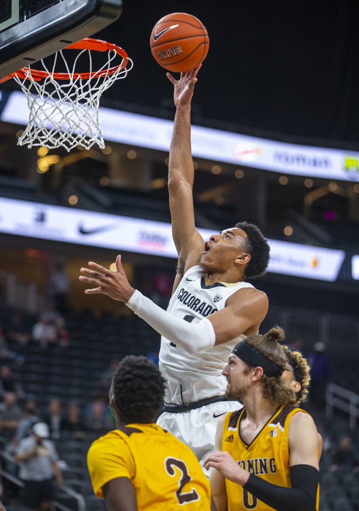 Colorado guard Tyler Bey (1) gets over the Wyoming defense for a basket during the first half o ...