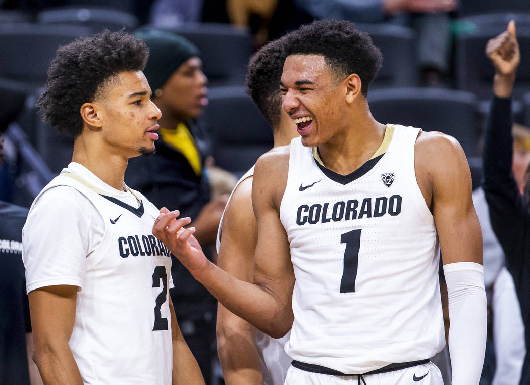 Colorado guard Tyler Bey (1, right) laughs with teammate Daylen Kountz (2) as the game winds do ...