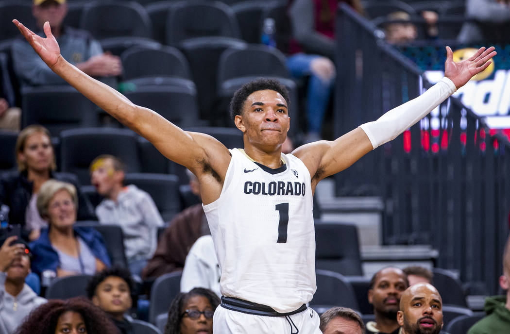 Colorado guard Tyler Bey (1) celebrates another score over Wyoming during the second half of th ...
