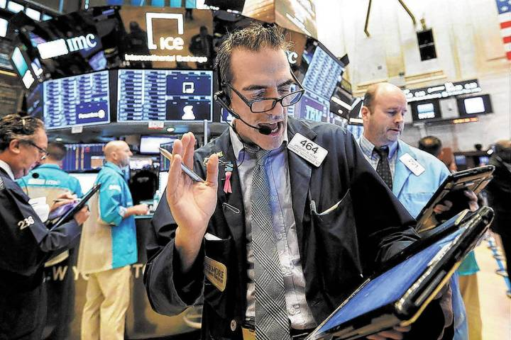 Trader Gregory Rowe works on the floor of the New York Stock Exchange, Friday, Jan. 18, 2019. ( ...