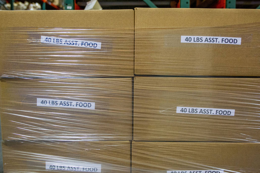 Assorted food boxes packed by the Las Vegas Albion Soccer Club ready to be delivered at Three S ...