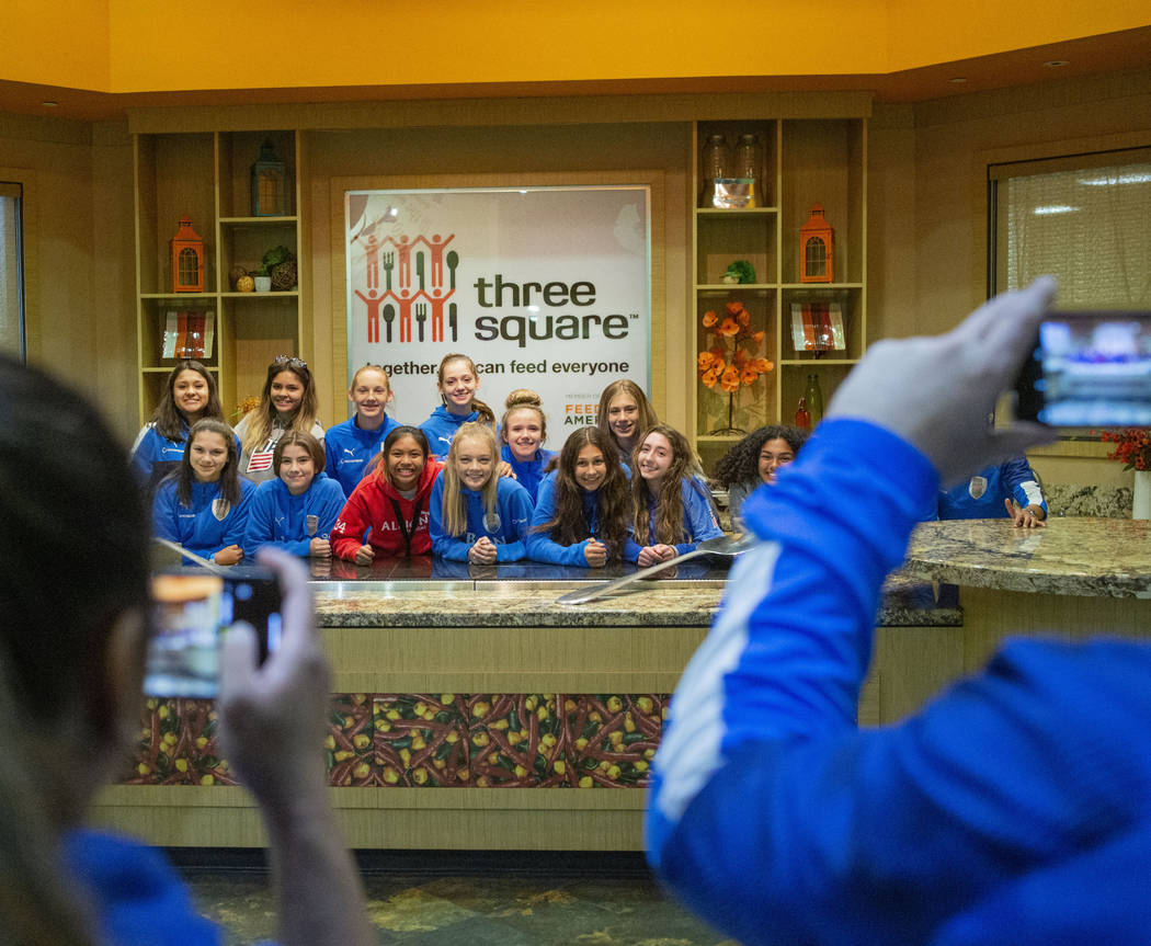 The Las Vegas Albion Soccer Club players take their photo after packing assorted foods in prepa ...