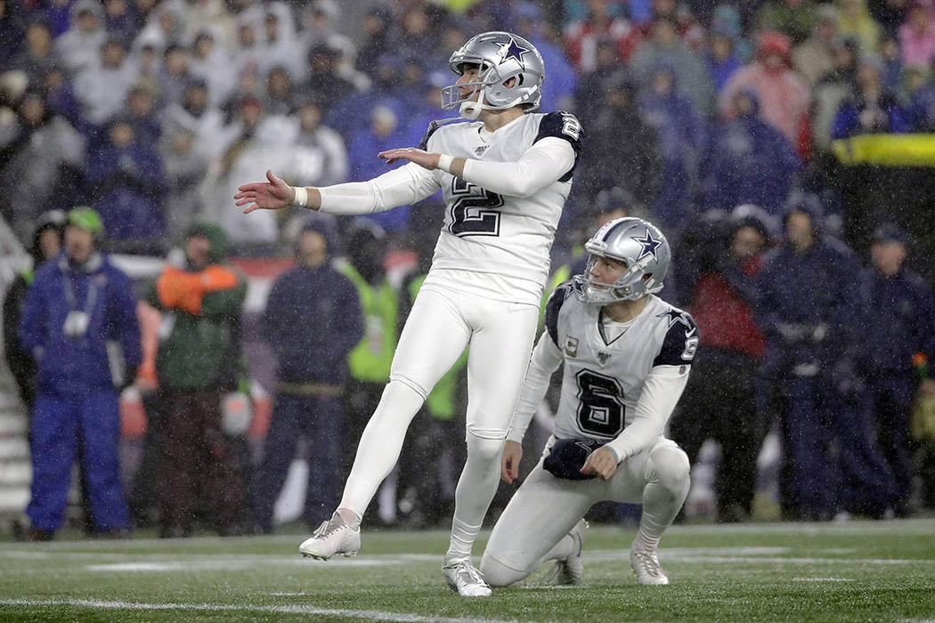 Dallas Cowboys kicker Brett Maher follows through on a field goal attempt in the first half of ...