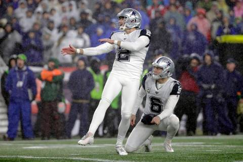 Dallas Cowboys kicker Brett Maher follows through on a field goal attempt in the first half of ...