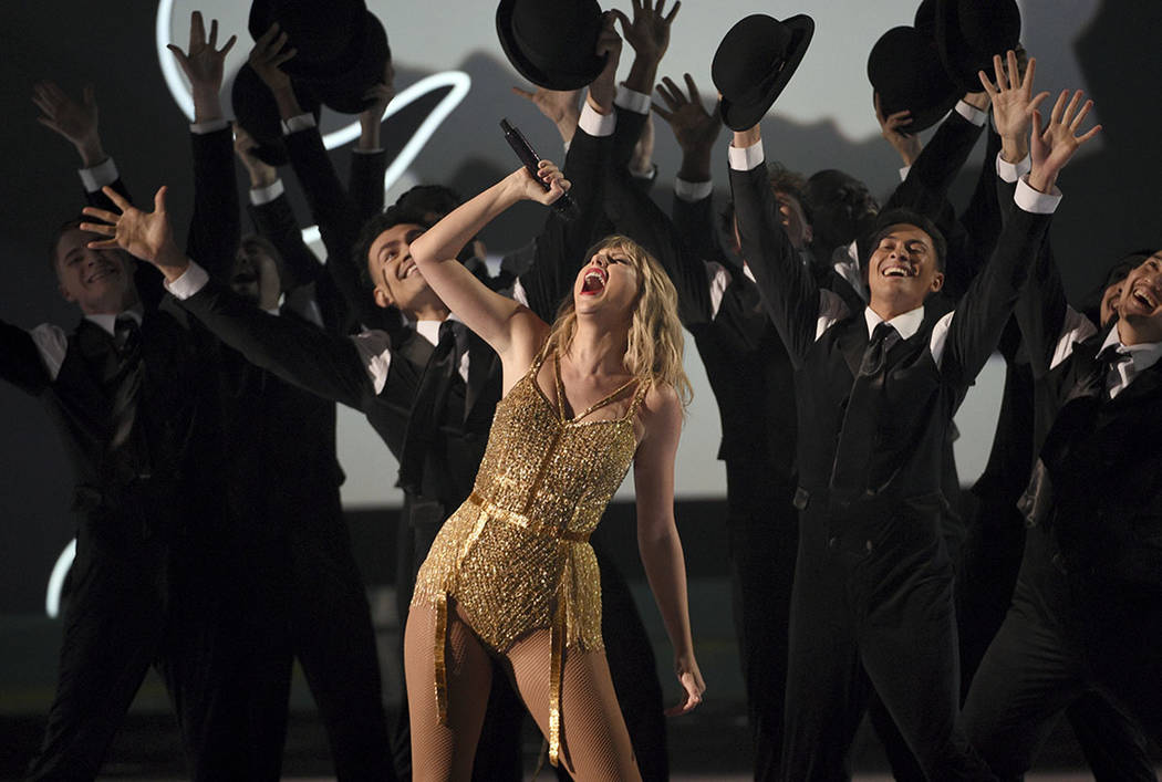 Taylor Swift, winner of the artist of the decade award, performs a medley at the American Music ...