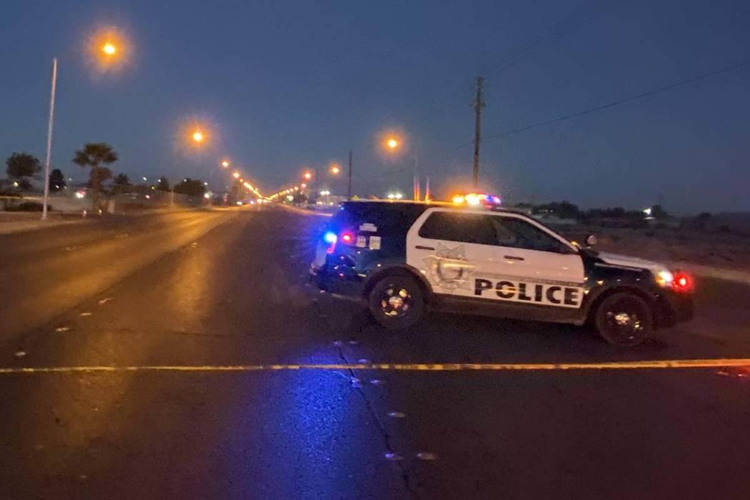 Crime scene tape and a Las Vegas Metropolitan Police Department squad vehicle block East Lake M ...