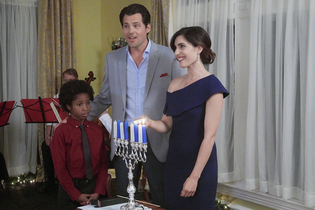 """In """"Double Holiday,"""" career-minded Rebecca's plans for Hanukkah go askew when a promotion opp ..."""
