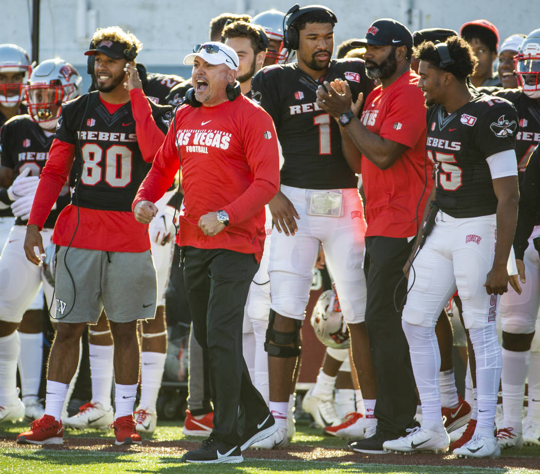UNLV Rebels head coach Tony Sanchez yells instructions to his players on the sidelines versus t ...