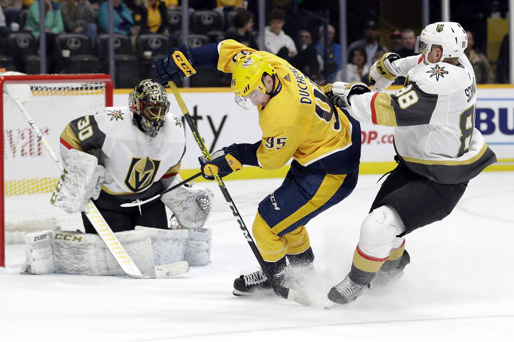 Nashville Predators center Matt Duchene (95) carries the puck between Vegas Golden Knights goal ...