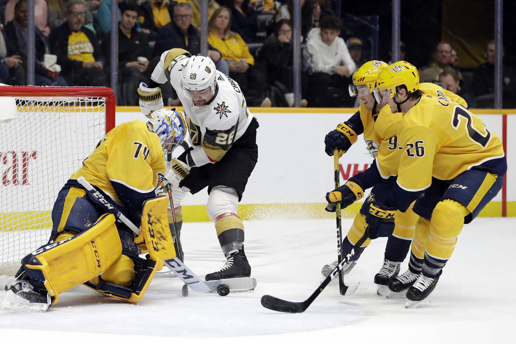 Nashville Predators goaltender Juuse Saros (74), of Finland, blocks a shot by Vegas Golden Knig ...