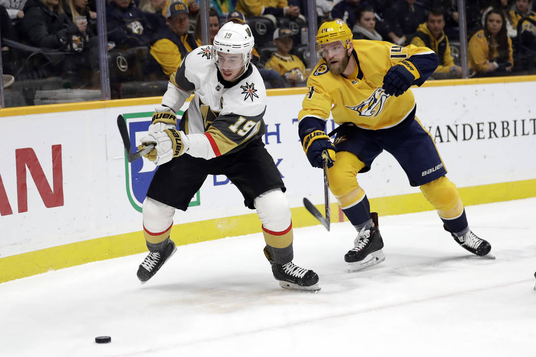 Vegas Golden Knights right wing Reilly Smith (19) and Nashville Predators defenseman Mattias Ek ...
