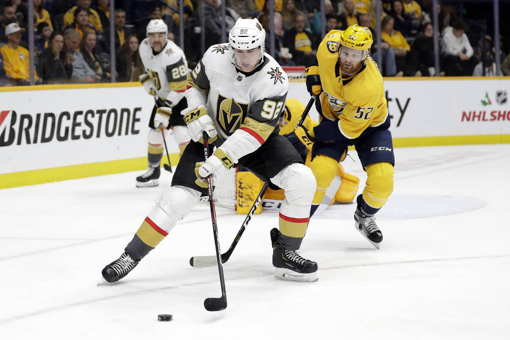 Vegas Golden Knights left wing Tomas Nosek (92), of the Czech Republic, moves the puck in front ...