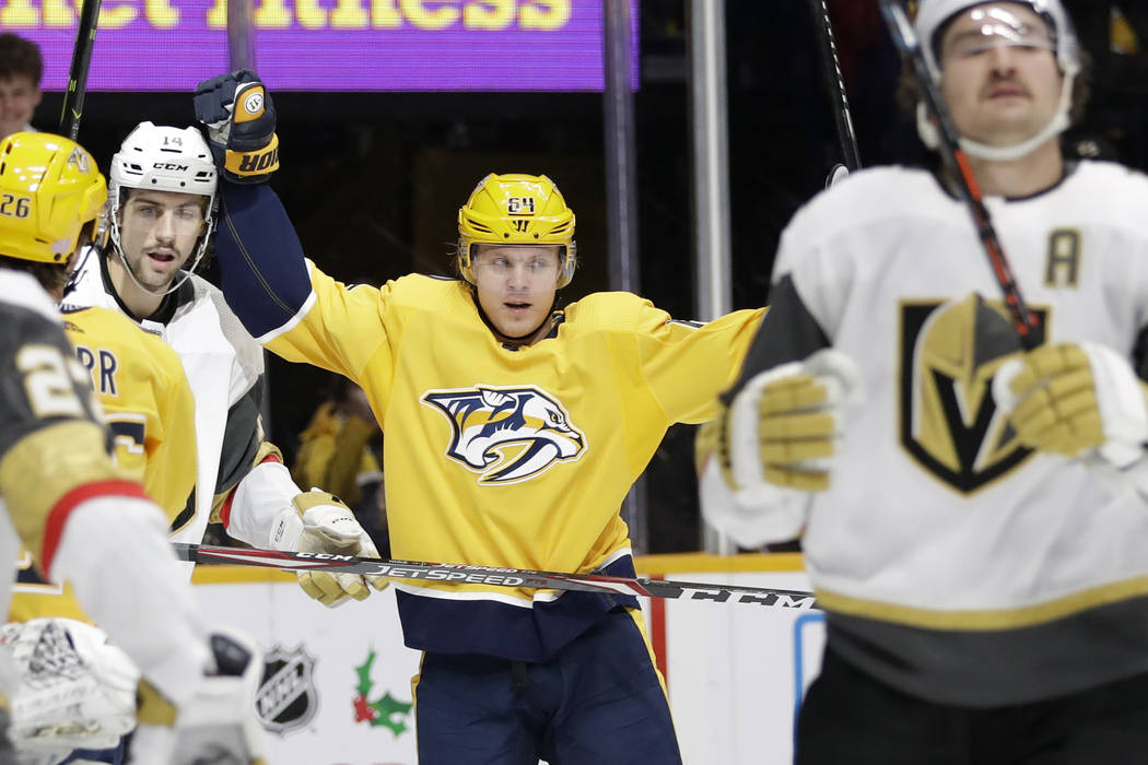 Nashville Predators center Mikael Granlund (64), of Finland, celebrates after scoring a goal ag ...