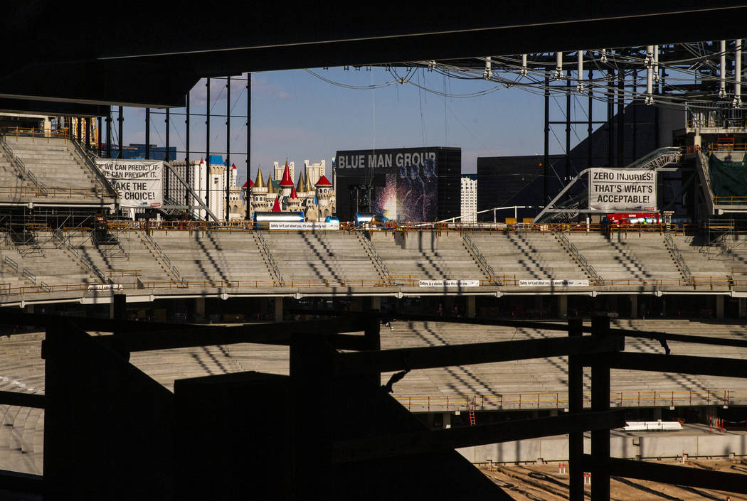 The stands with retractable doors beyond reveal a view of the Strip during a tour of the Raider ...