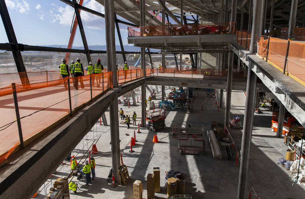 Crews continue work about the concourse area during a tour of the Raiders Allegiant Stadium con ...