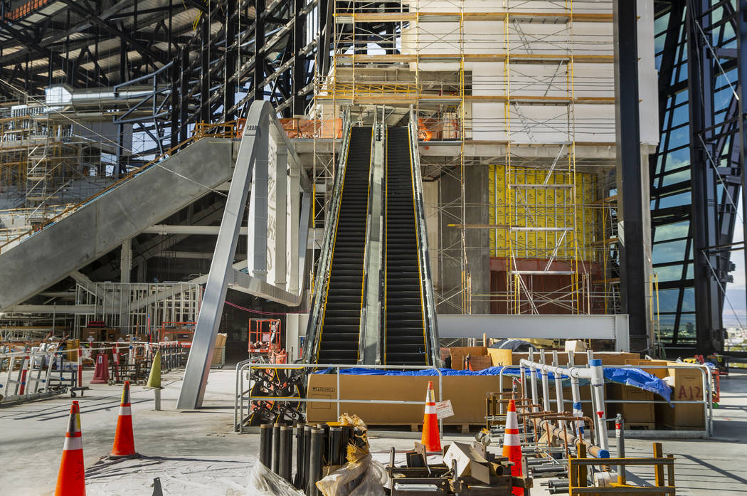 The upper concourse with escalators and Strip view during an Allegiant Stadium tour on Monday, ...