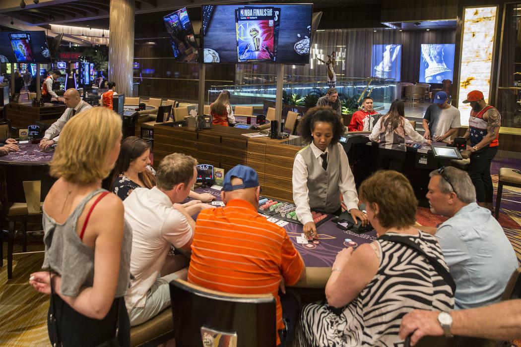 In this May 30, 2019, file photo, gamblers play blackjack at SLS Las Vegas in Las Vegas. (Benja ...
