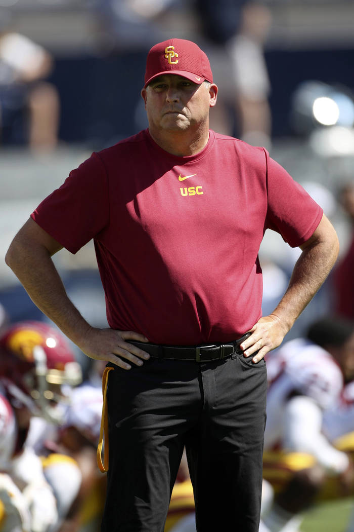 Southern California head coach Clay Helton watches his players warm up before a NCAA college fo ...