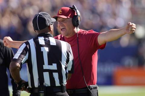 Southern California head coach Clay Helton argues with an official in the second half of an NCA ...