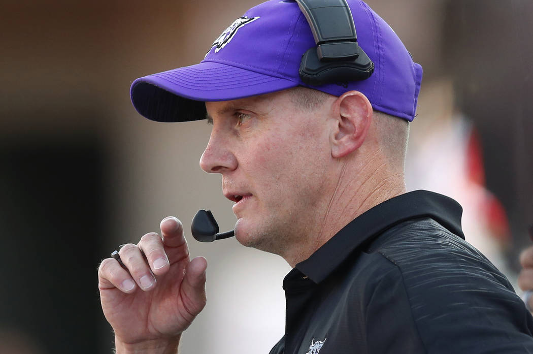 Weber State head coach Jay Hill watches during the first half of the NCAA college football game ...