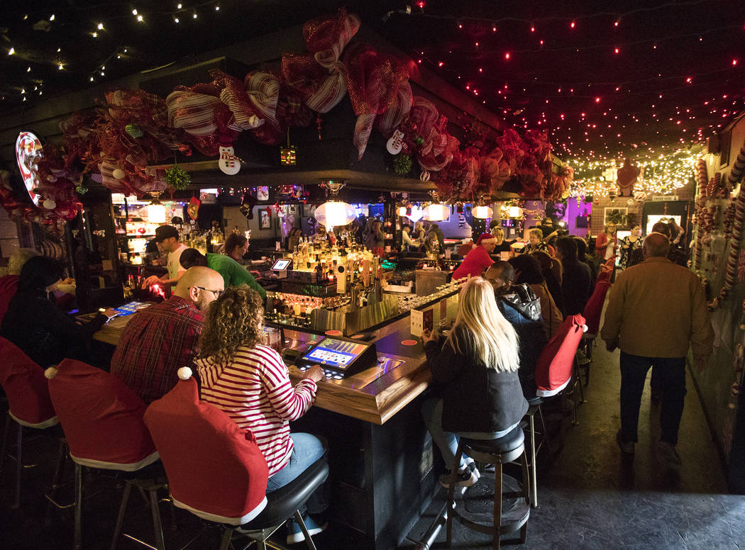 Guests at the bar of the Sand Dollar Lounge in Las Vegas, Monday, Nov. 25, 2019. The bar is hos ...