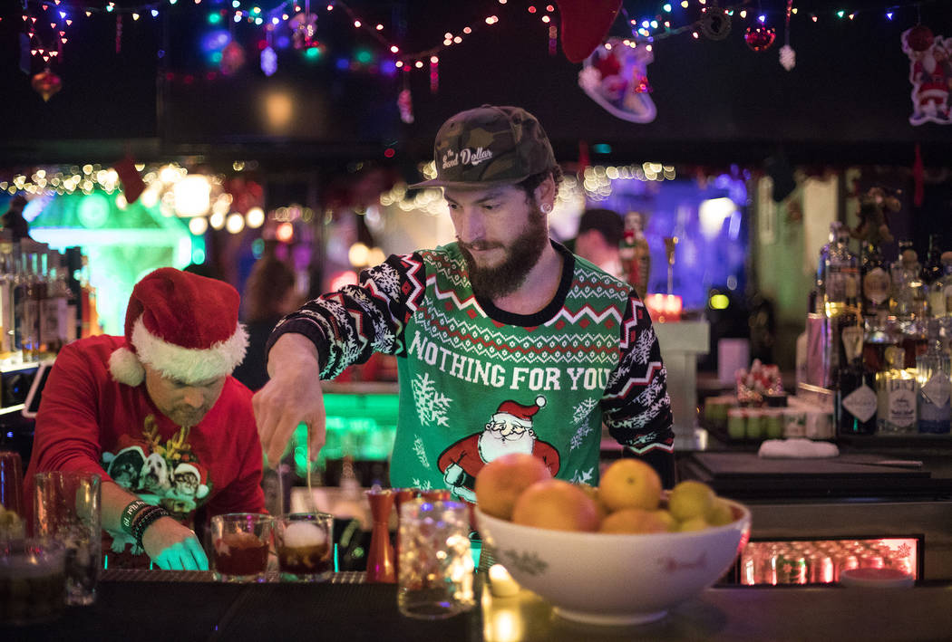 """Bartenders Clint """"Spotty"""" Spotleson, left, and Bryan Pierzga, right, mix drinks at th ..."""