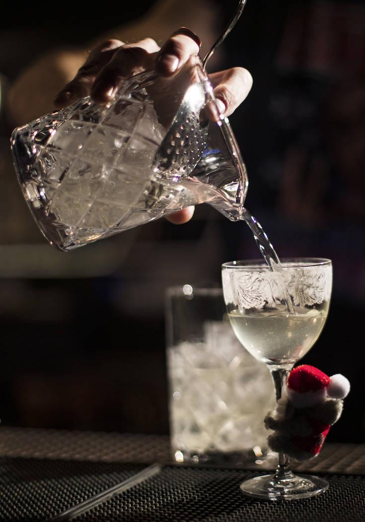 Bartender Keith Baker creates the Koala-La La La, La La La La cocktail made of gin, pine tea co ...