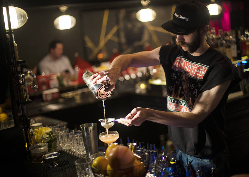 Bartender Keith Baker creates the Christmapolitan, made of vodka, elderflower, dry vermouth, sp ...