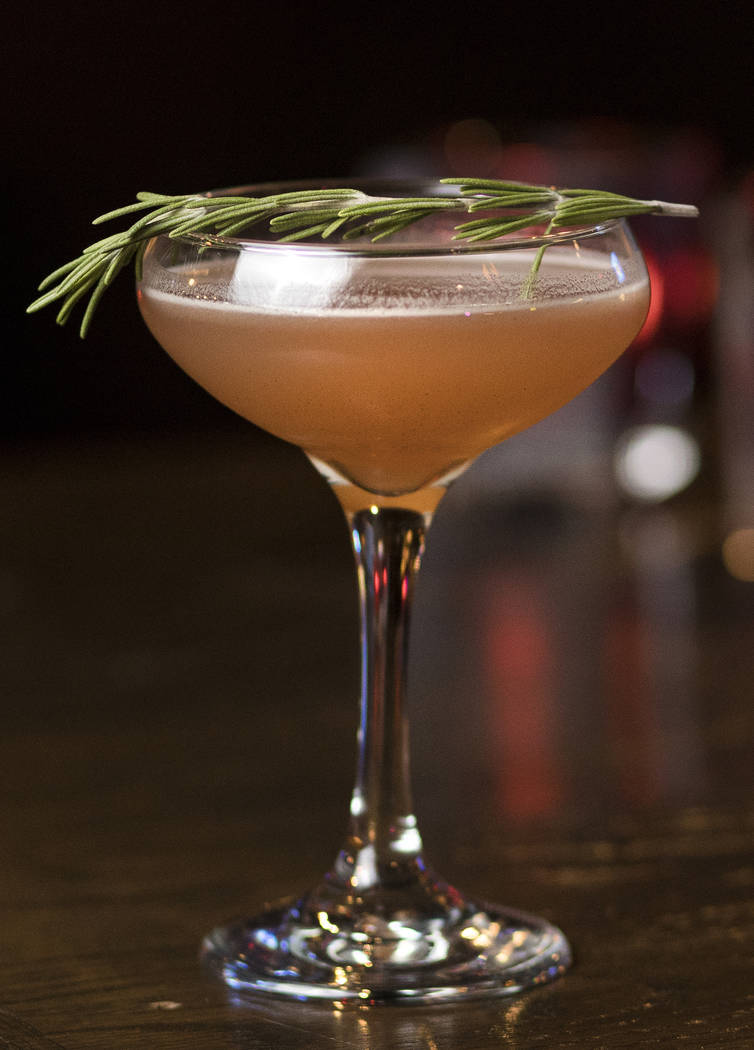 The Christmapolitan is made of vodka, elderflower, dry vermouth, spiced cranberry sauce, rosema ...