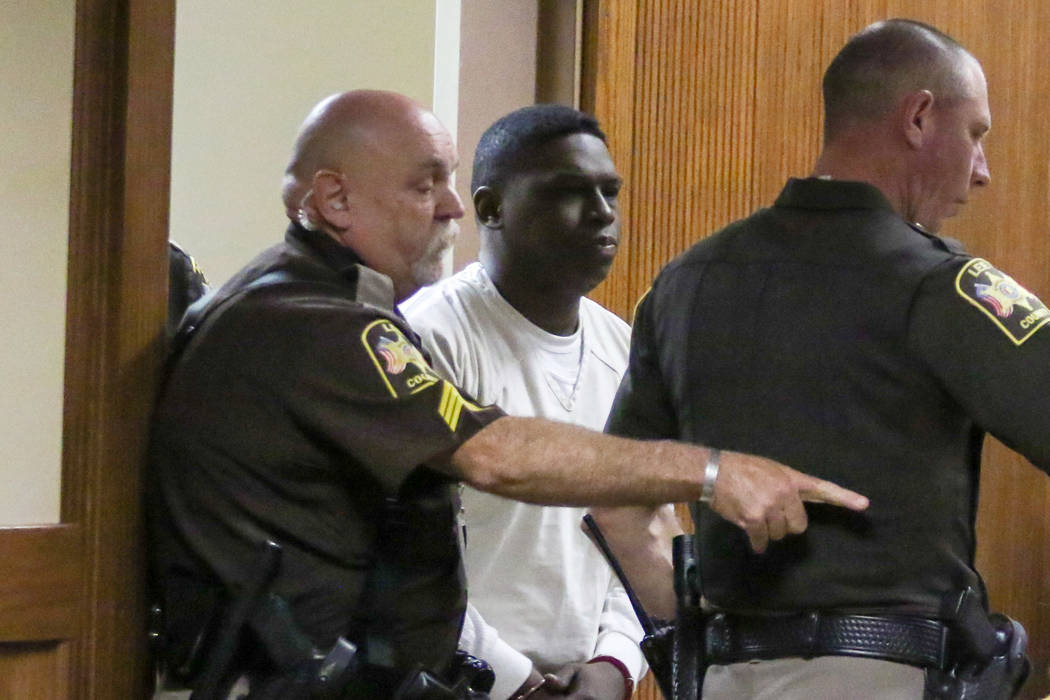 Ibrahim Yazeed, center, appears in court for a hearing on the disappearance of college student ...
