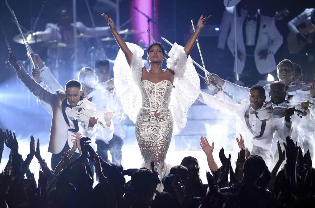 "Toni Braxton performs ""Unbreak My Heart"" at the American Music Awards on Sunday, Nov. ..."