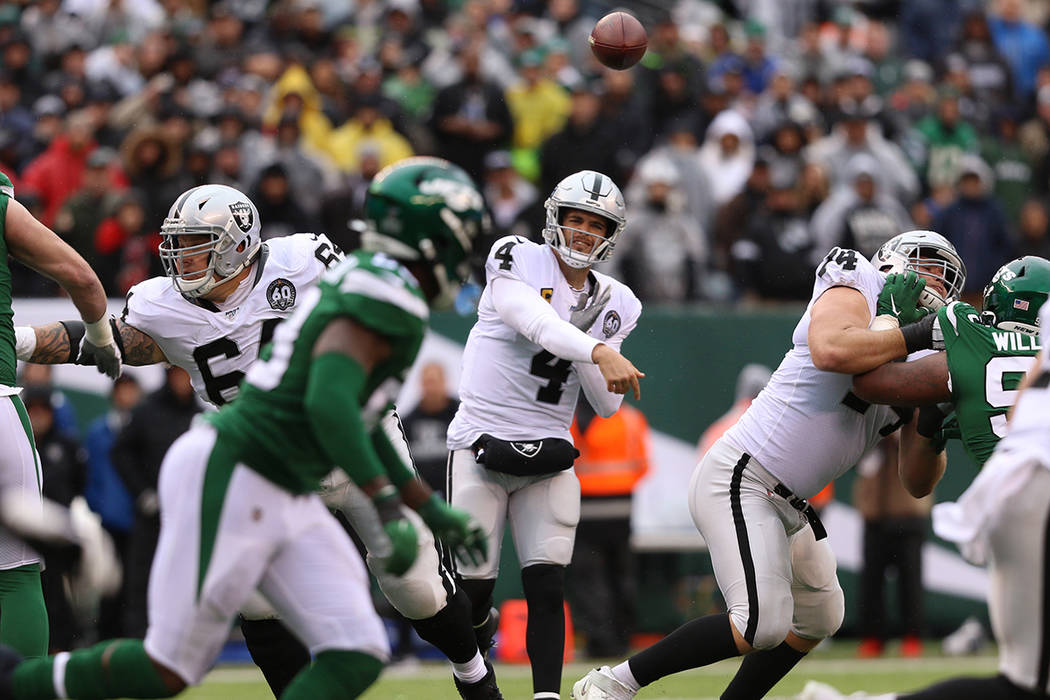 Oakland Raiders quarterback Derek Carr (4) throws the football during the first half of an NFL ...