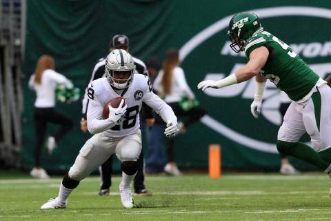 Oakland Raiders running back Josh Jacobs (28) runs with the football as New York Jets defensive ...