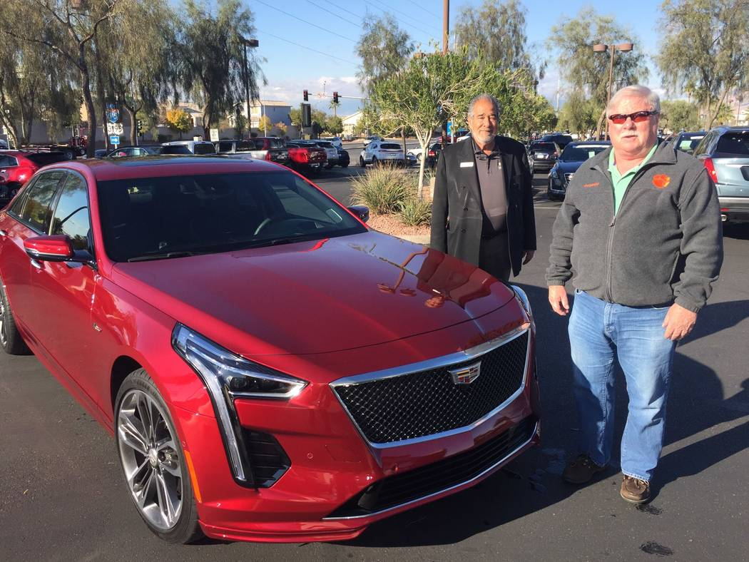 New Las Vegas resident Leonard Duchene, right, is seen with Findlay Cadillac sales consultant M ...