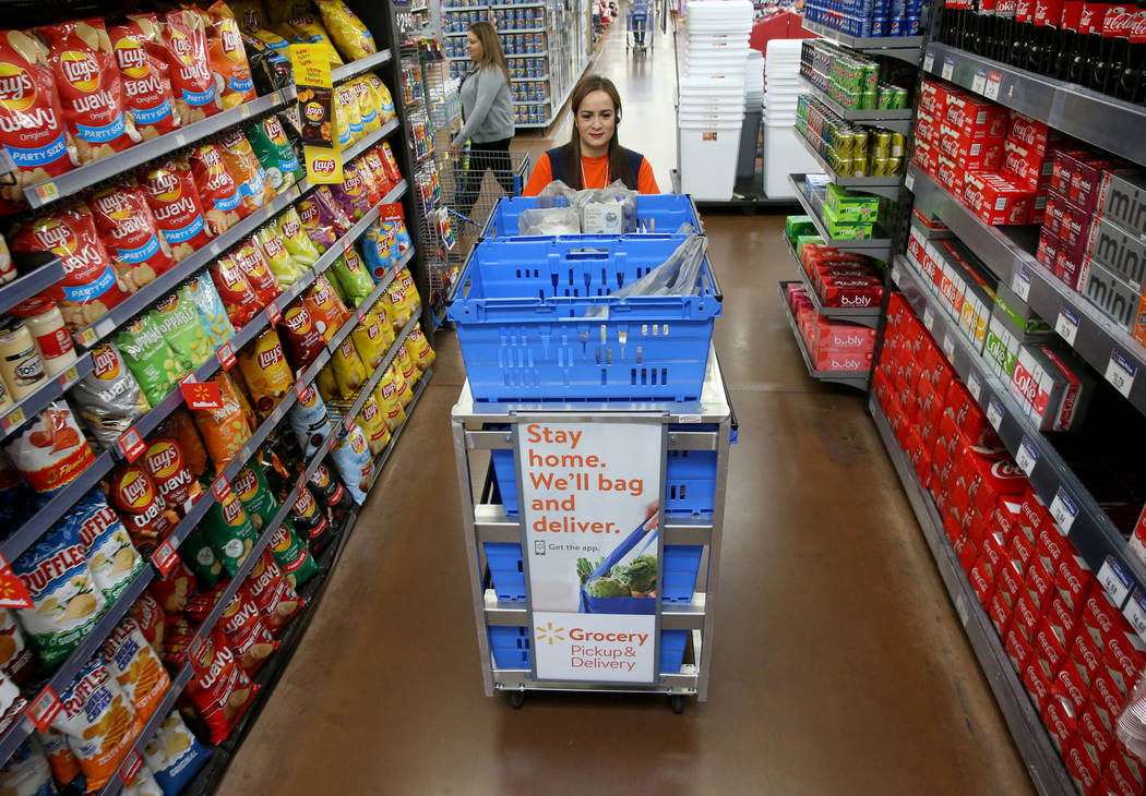 Personal shopper Alice Ribitch fills customer orders for pickup at Walmart at 7200 Arroyo Cross ...
